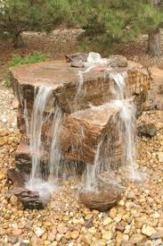 Core drilled sandstone water feature, pondless