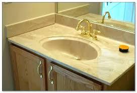 bathroom sink one piece and counter countertop corian