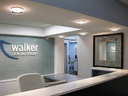 dental office reception. Prominent Logo Behind Reception Dental Office
