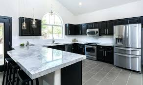 black and white countertops black and white marble with designs white cabinets black countertops brick backsplash