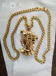 original 18karat gold necklace cuban design with medusa pendant in amuwo odofin jewelry neslon gold gold jiji ng for in amuwo odofin jewelry