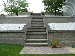 Agape Retaining Walls, Inc. designed and installed these retaining wall concrete  block steps. This type of step design fans out ...