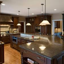 The primary color in this granite is brown; 5 Perfect Kitchen Countertop And Flooring Matches For Dark Cabinets