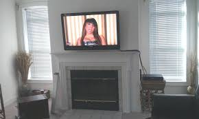 tv above fireplace ideas interior installing a above the fireplace hg inside hanging above fireplace renovation