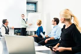 how to a job in the n job market business presentation in a team a female colleague is standing on the flipchart and