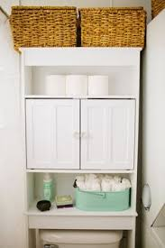 towel storage above toilet. Features: -Space Saver Wall Cabinet. -Provides Organization And Storage For Bathroom. -Fits Over Standard Toilet Tanks. -Wood Door Pulls. -Woo\u2026 | Bathroom\u2026 Towel Above V
