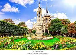 notre dame paris garden stock photos