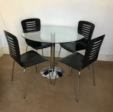 round glass table 100cm diameter and 4 black wooden chairs
