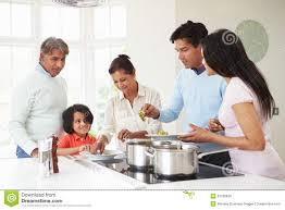Family Kitchen Multi Generation Indian Family Cooking Meal At Home Stock Image