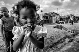photo essay photojournalism through the streets of mathare slum nairobi the contrast between the innocent beauty of the young girl the vivid diffidence of the boy behind her