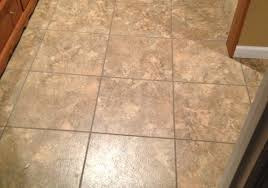 install luxury vinyl tile in their laundry room and from the bottom of their stairs to the wet bar area and walk out basement door