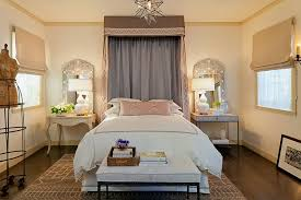 mirrors accentuate the beauty of the table lamps in this mediterranean bedroom design laura