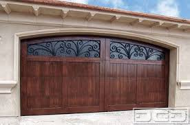 Image Sectional Italian Mediterranean Style Garage Doors With Decorative Iron Window Scrollings Pinterest Italian Mediterranean Style Garage Doors With Decorative Iron Window