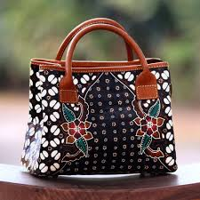 hand painted red and white flowers on black leather handbag truntum garden