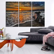 beautiful sunset on beach and small waves photo canvas print sunset extra large wall art canvas print on 3 panel wall art beach with beautiful sunset on beach and small waves photo canvas print