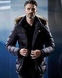 ben hill wears nylon quilted puffer jacket with fur hood moncler
