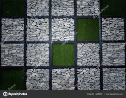 stone walls and artificial grass stock photo