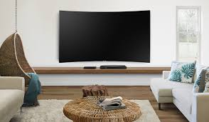 samsung curved tv in living room. maximise your tv enjoyment by cleaning up those messy cables in the back. clean cable solution and one connect make everything neat simple.* samsung curved tv living room