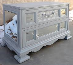 silver paint for furniture. mirrors cut to size and glued in placetop front drawer was done using a silver paint for furniture o