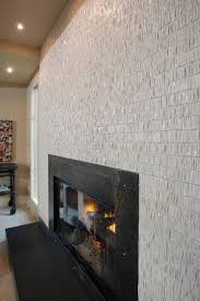 photos custom black fireplace with textured tile surround