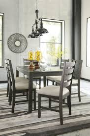 very attractive 7 piece dining table set signature design by ashley rokane brown room under 500 dollars round