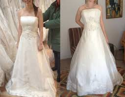 did you wear a hoop skirt with your a line? share pics please Wedding Dress With Hoop here's a picture of me trying on my dress with nothing underneath, and then again with a regular sized petticoat underneath not nearly full enough! wedding dresses with hoods