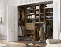 Custom reach in closets California Closets Dark Wood Reach In Closet With Closet Rods And Light Brown Drawers And Shelving California Closets Reachin Closets Designs Ideas By California Closets