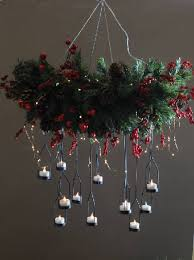 this chandelier by trees n trends was created by flipping a wreath upside down attaching strands of picture wire to create a hanger
