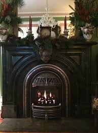 valor portrait gas fireplace with coal fire effect and polished windsor arch installed in antique fireplace mantel