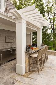 rustic outdoor kitchen patio traditional with wicker bar stools house flags
