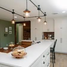 track lighting in kitchen. Perfect Track Industrial Track Lighting Over Eat In Dining Area In Open Country Kitchen With C