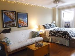 alluring small spaces one bedroom apartments interior design ideas white upholstered living room sofa brown laminate wooden floor fl pattern bed sheet