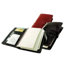 spiral bound planner and organizer with crocodile grained leather cover