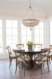 tan beaded chandelier with round concrete top table