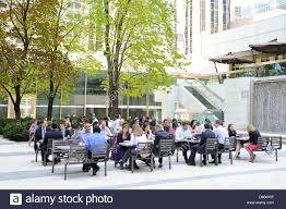outdoor office space. Office Workers Taking Lunch Break At An Outdoor Park Setup With Tables And Chairs Resembling A Lunchroom First Canadian Place Space E