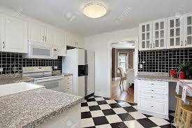 Checkerboard Kitchen Floor Kitchen In Suburban Home With Checkerboard Floor Stock Photo