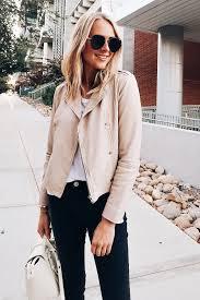 blonde woman wearing hinge feminine leather jacket blush white tshirt hudson barbara black skinny jeans senreve
