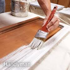 How to Spray Paint Kitchen Cabinets | Family Handyman