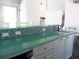 Minimalist Kitchen With Tempered Glass 2 Tier Island Countertops, White Kitchen  Cabinet Ideas, And