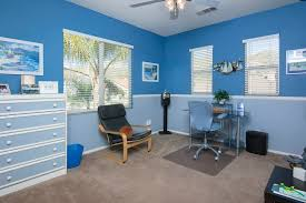 eclectic home office. Eclectic Home Office With Beam Ceiling, Blue Walls And Freestanding Shelves.Source: Zillow Digs