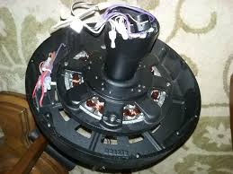 see exposed capacitors br br br my fan had 8 s holding the cast iron in place br then 4 more s holding the interior metal ring br