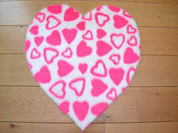 pink hearts heart shaped non slip machine washable sheepskin style kids rug size 70cm x