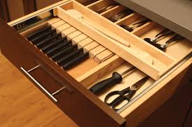 the slotted knife holder can be below a two tier cutlery tray for maximum