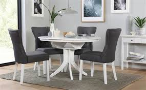 table and 6 chairs. hudson round white extending dining table with 6 bewley slate chairs and