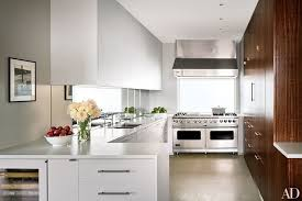 An Upper East Side, Manhattan, duplex's simple kitchen sparkles with white  Corian cabinetry and
