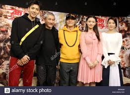 """From left) Chinese actor Kris Wu, Hong Kong director Tsui Hark and actor  Stephen Chow pose at a promotional conference for their new movie """"Journey  t Stock Photo - Alamy"""