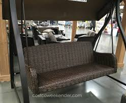 relax outside in the comfort of the agio international woven patio swing