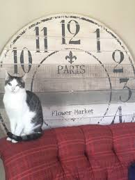 found a huge wall clock just missing hands not sure whether to fix it to or keep either way the cat approves