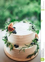 Rustic Wedding Cake Decorated With Figs And Greenery Rosemary Stock