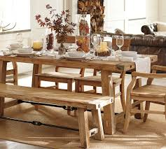simple distressed farmhouse kitchen table with white burlap runner and flower glass centerpieces plus candle holder